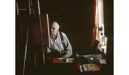 Bern Will Brown painting in his studio
